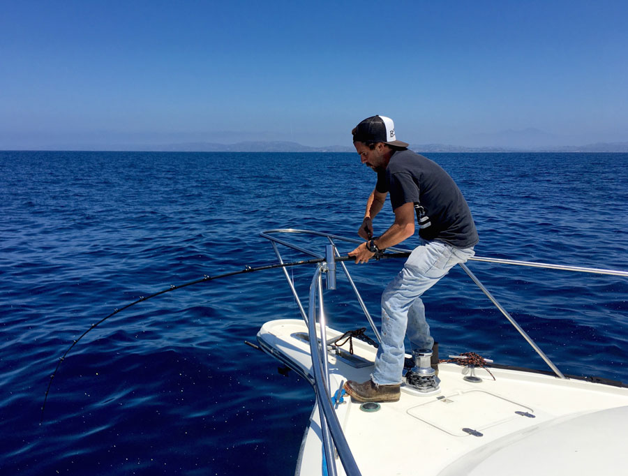 Capt. Ben Knight pinned to the bow of Bongos III, just a few miles outside of Dana Point.